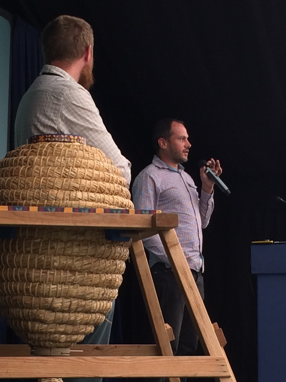 Robin Baxter speaking at the conference, and a hive made by prisoners