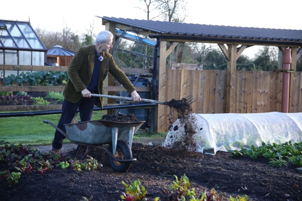 Spreading compost to feed soil life